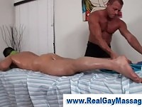 Gay masseur oiling a naked guy