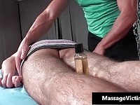 Kinky masseur lowers his relaxaction massage below the waist.