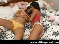 Sweet brunette lesbians kissing and rubbing