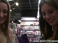 Stunning teens visiting a sex toy store