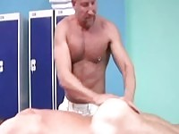 Mature masseur in action
