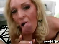 Mega boob cougar mom tugging and sucking stiff cock