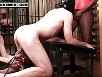 Carmen torturing his cock while he's sucking on a strap-on
