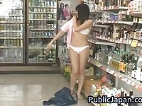 Sexy asian doll iundressing in a public shop!