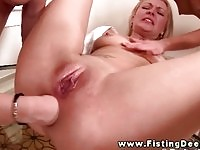 A sexy blonde dyke gets her ass fisted