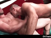 Short haired guy sucking on a large cock!