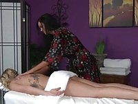 A tattooed blonde getting massaged