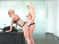 Two yummy big breasted dykes enjoying themselves on a desk