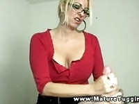 Busty blonde mature with glasses jerking off some stud