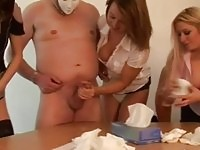 Sexy office babes giving handjob