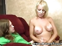 Perfect blonde mature jerking a young hard dick