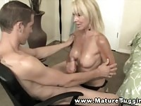 Sexy blonde MILF uses her hands and boobs to jerk off this fat cock