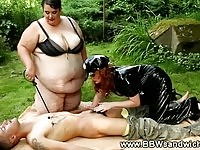 Two nasty BBW fetish dominas are punishing a skinny stud
