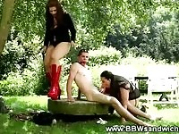 Gagged subject spanked and sucked outdoors