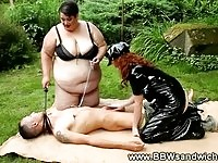 Two BBW dominas are whipping and sucking their subject