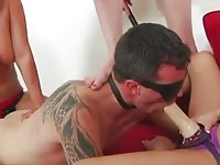 Femdom babes pegging a blindfolded guy's ass