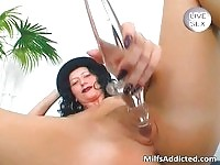 Brunette german MILF playing with her glass dildo