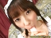 Japanese%20maid%20sucking%20on%20dildo%20while%20getting%20jizzed