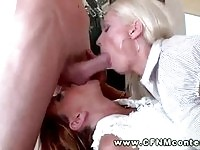 Three glam babes sucking on a large cock