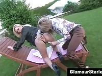 Glamorous blondes trash the grass in the back yard.