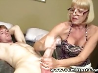 Horny mature blonde rubs young cock and gets facial