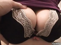 A busty babe is exposing her tits