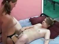 Lesbian beauties using their new strap on toy