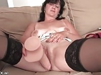 A  sexy brunette granny toying