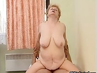 Nasty fat granny riding on a hard cock