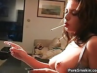 Busty chick smoking topless