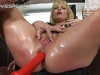 Hot blonde MILF gets her holes filled with toys