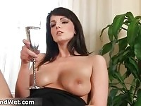 Sensual brunette babe toying her pussy and pissing in a champagne glass
