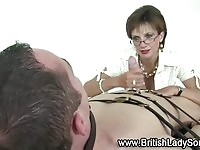Lusty mature femdom sucking and tugging cock
