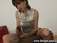 Hot british MILF gives a handjob to this this big black cock