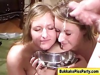 Two dirty blondes getting facials and piss