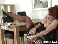 Busty mature redhead toying!