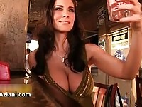 Sexy drunk babe exposing large boobs in a bar