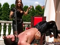 Sexy Russian mistress handling her slave