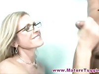 Blonde MILF with glasses tugging a massive dick