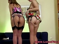 Two classy lesbian Brits putting on their stockings