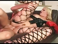 Busty blonde latex babe gets it in the ass!