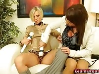 Two delicious upper class lesbians toying each others pussies