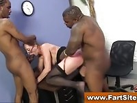 Amazing MILF takes good care of two big black cocks