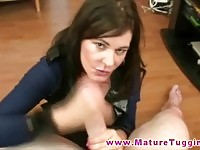 Busty MILF stroking on dick like a pro