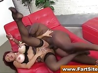 Hot redheaded cougar in stockings fucked by a big black cock