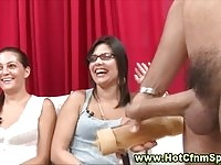 Dude toying in front of three babes