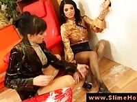 Foot fetish lesbians getting wet and messy by the gloryhole