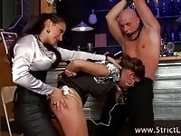 Lovely BDSM babe sucking on dick while fucked with a strapon