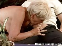 Horny blonde GILF gives head before riding dick