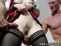 Hot MILF in schoolgirl uniform fucked by two old guys